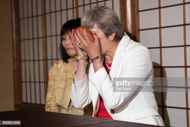 Britain's Prime Minister Theresa May takes part in a tea ceremony with Japan's Prime Minister Shinzo Abe on August 30 2017 in Kyoto Japan Mrs May is...