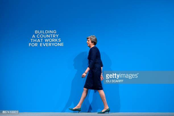 TOPSHOT Britain's Prime Minister Theresa May takes the stage to deliver her speech on the final day of the Conservative Party annual conference at...