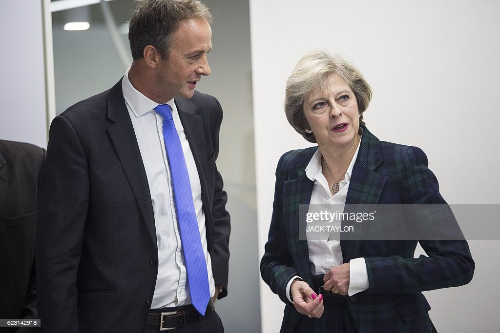 Britain's Prime Minister Theresa May (R) talks with charity Diabetes UK Chief Executive Chris Askew (L) during a visit to officially open the charity's new office in London on November 14, 2016. May, who has been diagnosed with Type 1 diabetes, officially opened the new Diabetes UK office today to coincide with World Diabetes Day. / AFP / POOL / Jack Taylor
