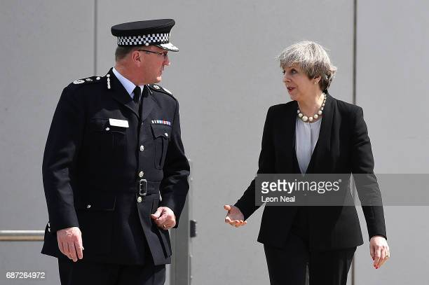 Britain's Prime Minister Theresa May talks with Chief Constable of Greater Manchester Police Ian Hopkins as they leave the Greater Manchester Police...