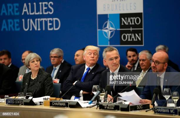 Britain's Prime Minister Theresa May US President Donald Trump and NATO Secretary General Jens Stoltenberg look on as Belgian Prime Minister Charles...
