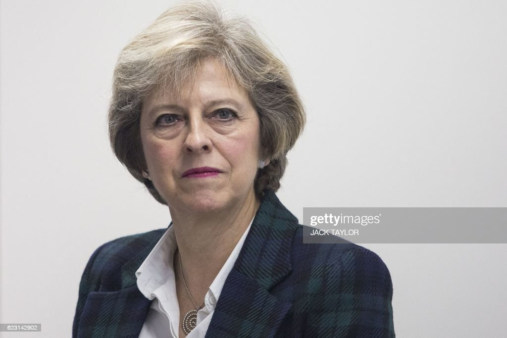 Britain's Prime Minister Theresa May visits to officially open the charity Diabetes UK's new office in London on November 14, 2016. May, who has been diagnosed with Type 1 diabetes, officially opened the new Diabetes UK office today to coincide with World Diabetes Day. / AFP / POOL / Jack Taylor