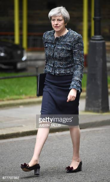 Britain's Prime Minister Theresa May walks outside 10 Downing Street in central London on May 3 after returning from Buckingham Palace where she met...