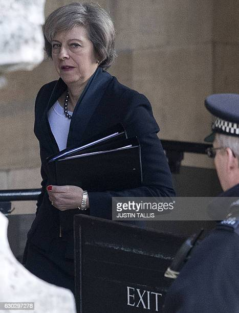 Britain's Prime Minister Theresa May walks through the Houses of Parliament in London on December 20 2016 ahead of an evidence session with the...