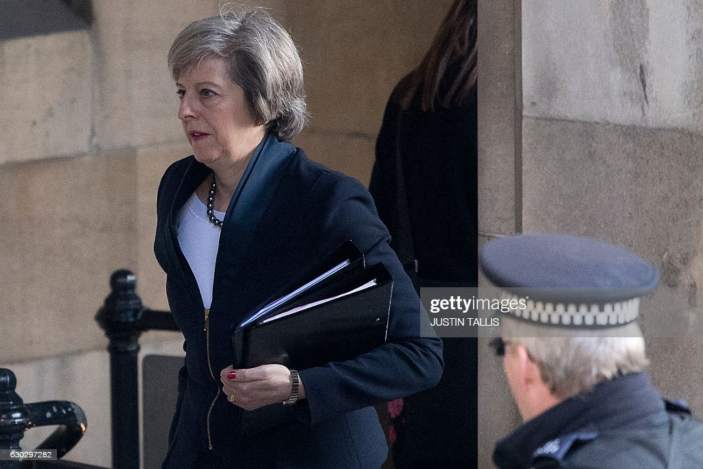 Britain's Prime Minister Theresa May walks through the Houses of Parliament in London on December 20, 2016 ahead of an evidence session with the Commons Liason Committee at the House of Commons. The prime minister was set to appear before the parliamentary committee to be questioned on Brexit. / AFP / Justin TALLIS