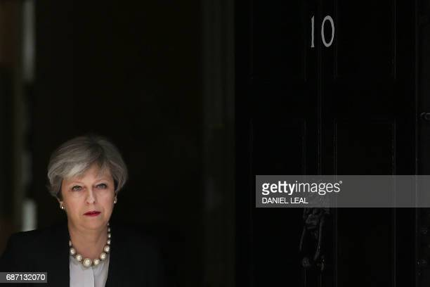 Britain's Prime Minister Theresa May walks to deliver a statement outside 10 Downing Street in central London on May 23 2017 after an emergency...