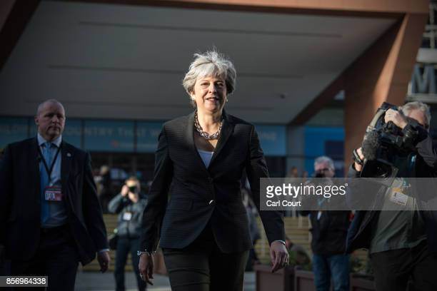 Britain's Prime Minister Theresa May walks to her hotel after conducting morning interviews on day three of the annual Conservative Party conference...
