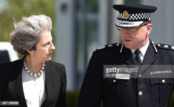 Britain's Prime Minister Theresa May walks with Chief Constable of Greater Manchester Police Ian Hopkins and Britain's Home Secretary Amber Rudd as...