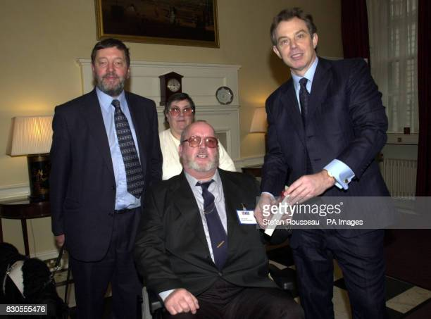 Britain's Prime Minister Tony Blair and Education Secretary David Blunkett present Jack Stone from the Midlands with a book titled Irish History by...