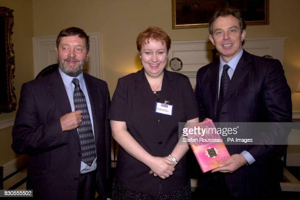 Britain's Prime Minister Tony Blair and Education Secretary David Blunkett present Heather Sargeant from Newcastle with a copy of Kate Hannigan's...