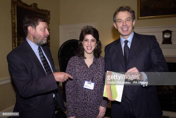 Britain's Prime Minister Tony Blair and Education Secretary David Blunkett present Angela Black from Essex with a copy of Miriam Stoppard's Healthy...