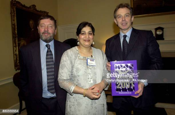 Britain's Prime Minister Tony Blair and Education Secretary David Blunkett present Nasrin Sheikh from High Wycombe with a copy of the Guinness World...