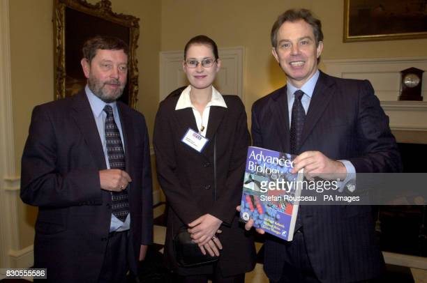 Britain's Prime Minister Tony Blair and Education Secretary David Blunkett present Amanda Ellis from Derbyshire with a book titled Advanced Biology...