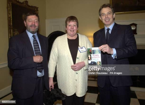 Britain's Prime Minister Tony Blair and Education Secretary David Blunkett present Linda Goddard from Birmingham with a copy of Pears Encyclopaedia...