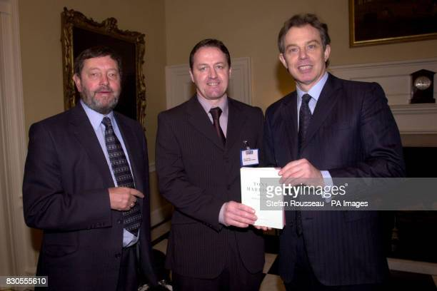 Britain's Prime Minister Tony Blair and Education Secretary David Blunkett present Paul Sutton from Liverpool with a book of Poems by Tony Harrison...