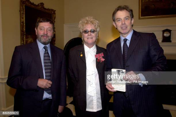 Britain's Prime Minister Tony Blair and Education Secretary David Blunkett present Sur Torr from Plymouth with A Child Called It by Dave Pelzer...