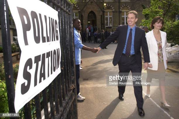 Britain's Prime Minister Tony Blair and his wife Cherie leave a polling station close to his official Downing Street residence in Westminster central...