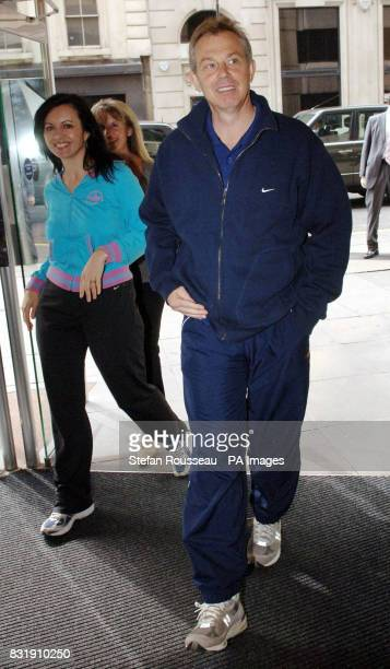 Britain's Prime Minister Tony Blair and Public Health Minister Caroline Flint arrive at the Central YMCA in London where they launched a new...
