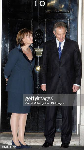 Britain's Prime Minister Tony Blair and wife Cherie outside their official London residence 10 Downing Street waiting for the arrival of Japanese...