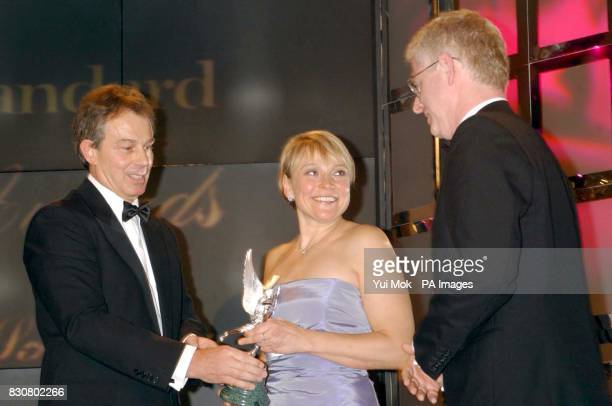 Britain's Prime Minister Tony Blair gives the award for Best Sreenplay to Richard Curtis and Helen Fielding for Bridget Jones's Diary during the...