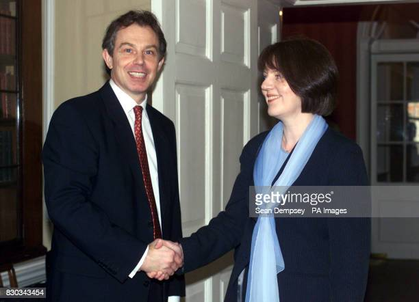 Britain's Prime Minister Tony Blair greets Ms Janet Saunders Ward Sister for Acute Care of the Elderly at St Martin's Hospital Bath and West...