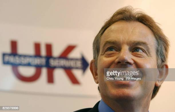 Britain's Prime Minister Tony Blair has his thumb print taken during a Biometric test at the Passport Office in central London The Prime Minister...