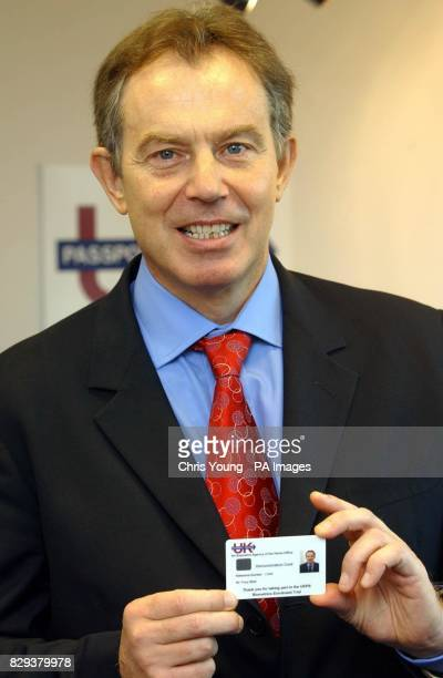Britain's Prime Minister Tony Blair holding his Biometric card at the Passport Office in central London The Prime Minister visited the Passport...