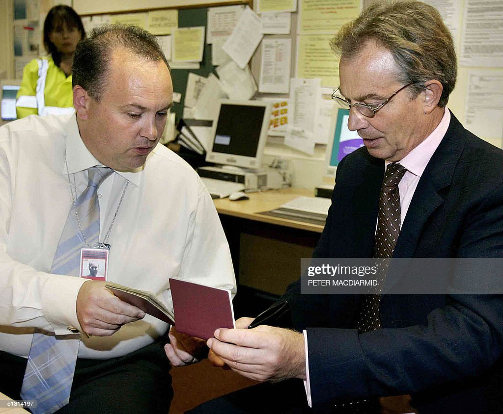 british prime minister tony blair views uk immigration services immigration services britain s prime minister tony blair r is shown false passports in the forgery room