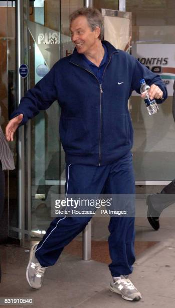 Britain's Prime Minister Tony Blair leaves the Central YMCA in London where he launched a new government intiative to encourage people to make a...