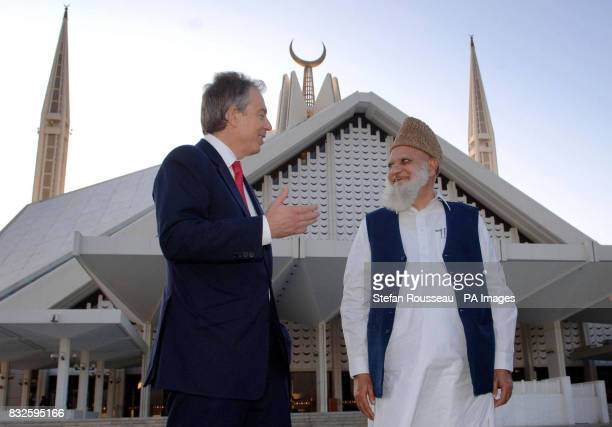 Britain's Prime Minister Tony Blair meets an Imam at the Faisal Mosque in Islamabad on the second day of his trip to Pakistan