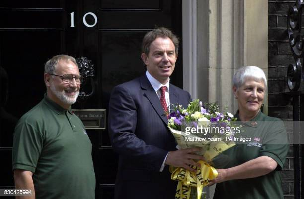 Britain's Prime Minister Tony Blair on the doorstep of 10 Downing Street in London where he received a bouquet of flowers from representatives of the...
