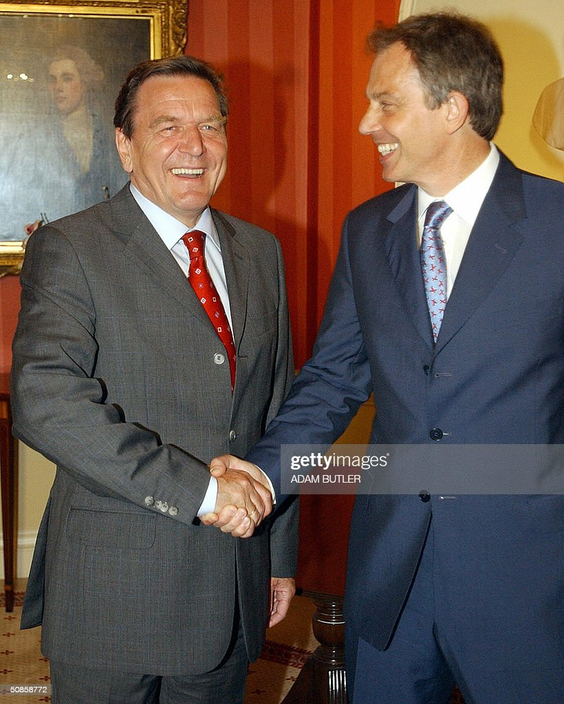 Britain's Prime Minister Tony Blair (R) shakes hands with German Chancellor Gerhard Schroeder prior to talks at 10 Downing Street in London, May 19, 2004.
