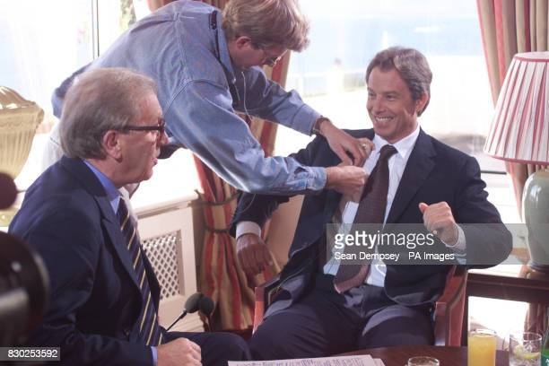 Britain's Prime Minister Tony Blair speaking with Breakfast with Frost presenter David Frost at the Highcliff Hotel in Bornemouth