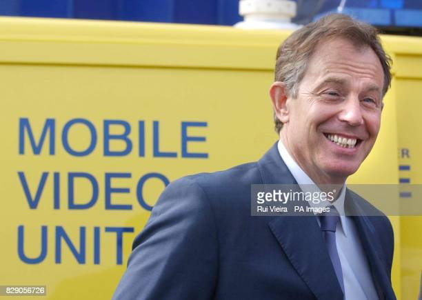 Britain's Prime Minister Tony Blair stands by the of a surveillance mobile video unit van during a visit to Whitefield Police station Manchester...