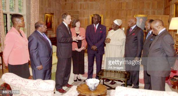 Britain's Prime Minister Tony Blair with Baroness Valerie Amos FO Minister for Africa President Benjamin M'kapa of Tanzania Mr Blair Clare Short...