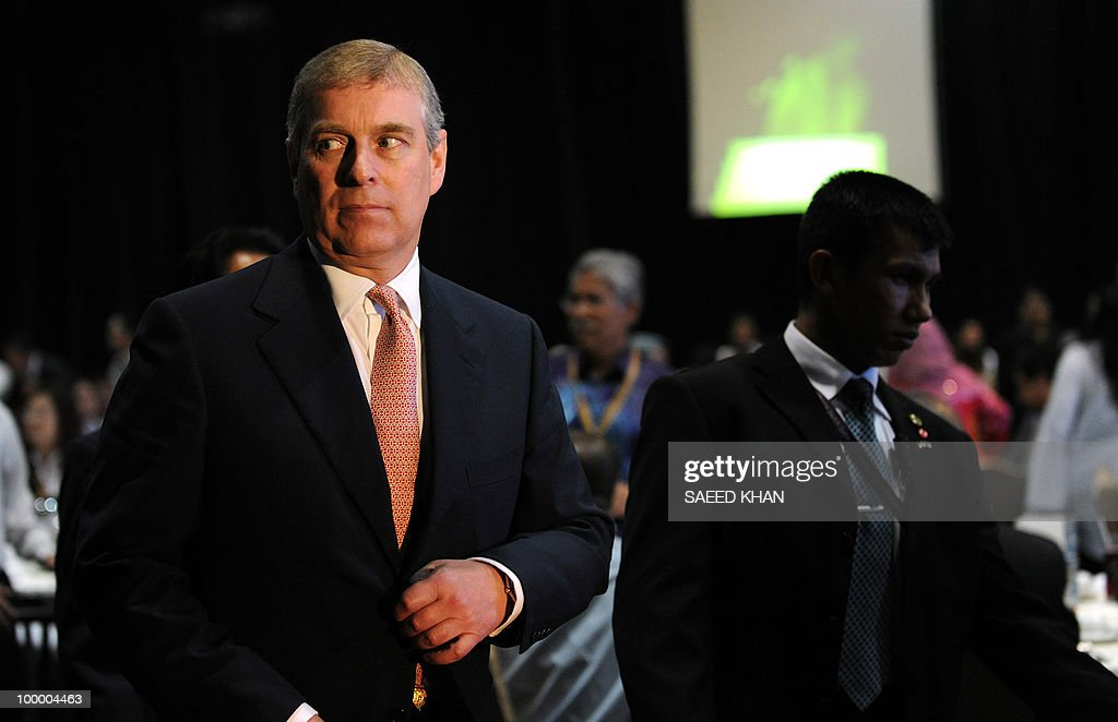 Britain's Prince Andrew (L) arrives to address delegates during a luncheon at the 6th World Islamic Economic Forum entitled 'Boosting UK Trade with the Islamic World: The Road Ahead' in Kuala Lumpur on May 20, 2010. Malaysia urged Muslim countries to lead the way in advocating the Islamic finance sector, saying it expects the 'positive trends' for the burgeoning industry to continue. AFP PHOTO / Saeed Khan