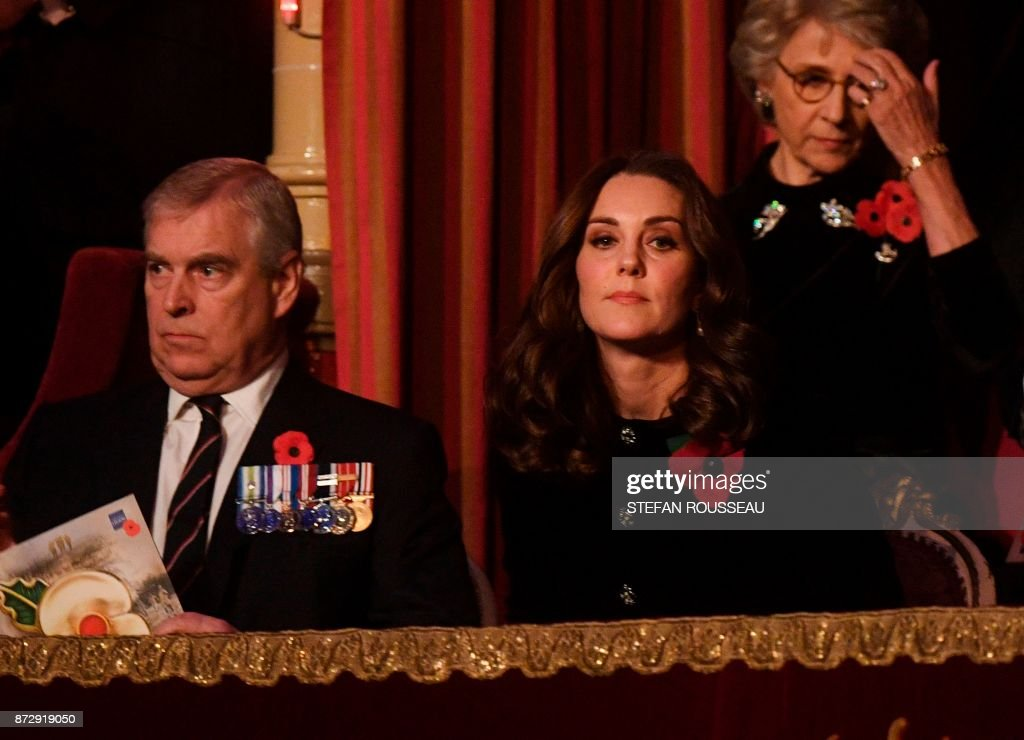 Britain's Prince Andrew, Duke of York, and Britain's Catherine, Duchess of Cambridge, attend the annual Royal Festival of Remembrance at the Royal Albert Hall in London on November 11, 2017 on Armistice Day. The Queen, accompanied by His Royal Highness The Duke of Edinburgh and other members of the Royal Family attended the annual Royal Festival of Remembrance at the Royal Albert Hall. The anniversary of Armistice Day, November 11, 1918, is marked in Britain with a number of events and acts of remembrance to honour those who fell in the two World Wars and subsequent conflicts. The red poppy is worn to symbolise the poppies which grew on French and Belgian battlefields during World War I. / AFP PHOTO / POOL / Stefan Rousseau