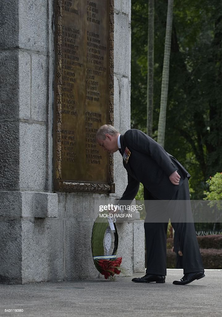 Britain's Prince Andrew, the Duke of York, lays a wreath during a service of remembrance ceremony for the Royal Commonwealth Ex-Services League (RCEL) who were killed in war, at the National Monument in Kuala Lumpur on June 26, 2016. The Royal Commonwealth Ex-Services League (RCEL) is a Commonwealth charity with 57 member organisations in 50 Commonwealth countries, including Malaysia. Malaysia was chosen to be the host of its 32nd conference from June 26 to 29. / AFP / MOHD