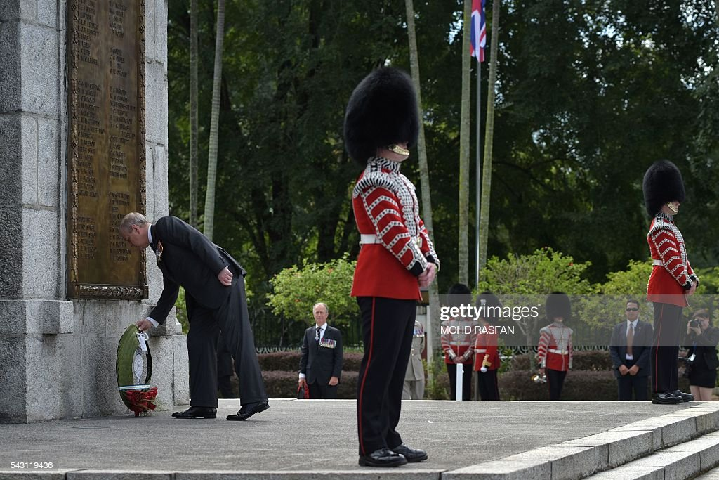 Britain's Prince Andrew, the Duke of York (L), lays a wreath during a service of remembrance by the Royal Commonwealth Ex-Services League (RCEL) for those killed in war, at the National Monument in Kuala Lumpur on June 26, 2016. The Royal Commonwealth Ex-Services League (RCEL) is a Commonwealth charity with 57 member organisations in 50 Commonwealth countries, including Malaysia. Malaysia was chosen to be the host of its 32nd conference from June 26 to 29. / AFP / MOHD