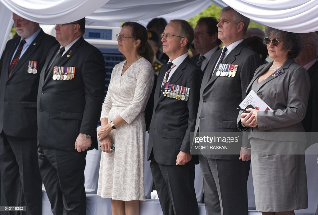 Britain's Prince Andrew, the Duke of York (2nd R), stands during a service of remembrance ceremony by the Royal Commonwealth Ex-Services League (RCEL) who those killed in world, at the National Monument in Kuala Lumpur on June 26, 2016. The Royal Commonwealth Ex-Services League (RCEL) is a Commonwealth charity with 57 member organisations in 50 Commonwealth countries, including Malaysia. Malaysia was chosen to be the host of its 32nd conference from June 26 to 29. / AFP / MOHD