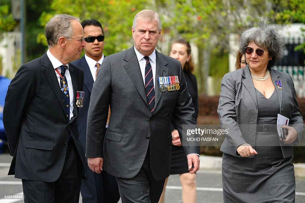 Britain's Prince Andrew, the Duke of York (C), walks after attending a service of remembrance ceremony by the Royal Commonwealth Ex-Services League (RCEL) for those killed in world, at the National Monument in Kuala Lumpur on June 26, 2016. The Royal Commonwealth Ex-Services League (RCEL) is a Commonwealth charity with 57 member organisations in 50 Commonwealth countries, including Malaysia. Malaysia was chosen to be the host of its 32nd conference from June 26 to 29. / AFP / MOHD