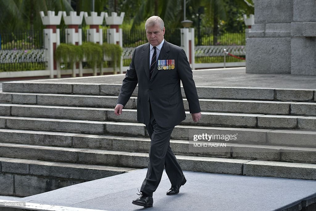 Britain's Prince Andrew, the Duke of York, walks after laying a wreath during a service of remembrance ceremony for the Royal Commonwealth Ex-Services League (RCEL) who were killed in war, at the National Monument in Kuala Lumpur on June 26, 2016. The Royal Commonwealth Ex-Services League (RCEL) is a Commonwealth charity with 57 member organisations in 50 Commonwealth countries, including Malaysia. Malaysia was chosen to be the host of its 32nd conference from June 26 to 29. / AFP / MOHD