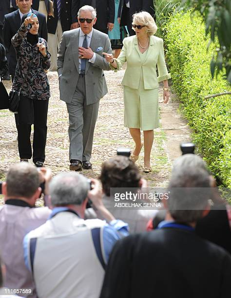 Britain's Prince Charles and his spouse Camilla visit on April 5 2011 a park in the Oudayas Kasbah a fortified neighborhood of Rabat on the coast The...