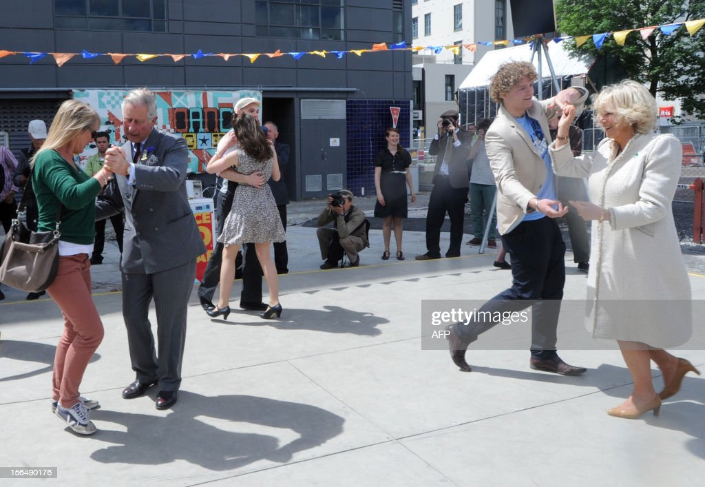 Britain's Prince Charles (2nd L) and his wife Camilla (R) dance during a rock n roll dance display in Christchurch on November 16, 2012. Britain's Prince Charles and his wife Camilla are on the last leg of a tour to mark Queen Elizabeth II's diamond jubilee which has also included Papua New Guinea and Australia and ends on November 16. AFP PHOTO / POOL / Ross Setford