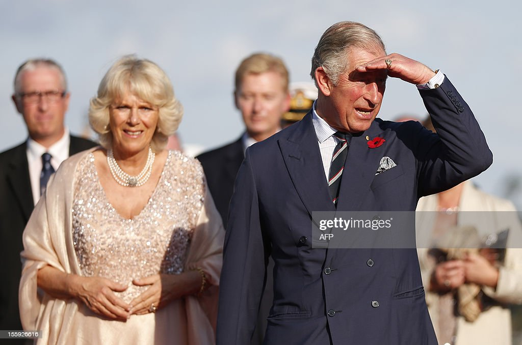 Britain's Prince Charles and his wife Camilla, Duchess of Cornwall arrive at the Sydney Opera House after crossing Sydney Harbour on the Admiral's Barge on November 9, 2012. Britain's Prince Charles and his wife Camilla are in Australia on the second leg of a Diamond Jubilee Tour taking in Papua New Guinea, Australia and New Zealand. AFP PHOTO / POOL / Tim Wimborne
