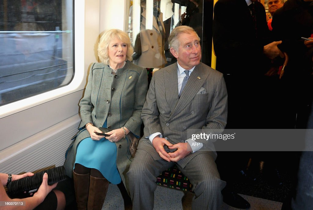 Britain's Prince Charles (Seated R) and his wife Camilla, Duchess of Cornwall (Seated L) travel on a Metropolitan underground train from Farringdon to London's Kings Cross as they mark 150 years of the London Underground on January 30, 2013. The London Underground was the world's first underground railway, then known as the Metropolitan Railway, unveiled its first stretch of track between Paddington and Farringdon on January 9, 1863, with passengers making their first journeys a day later.