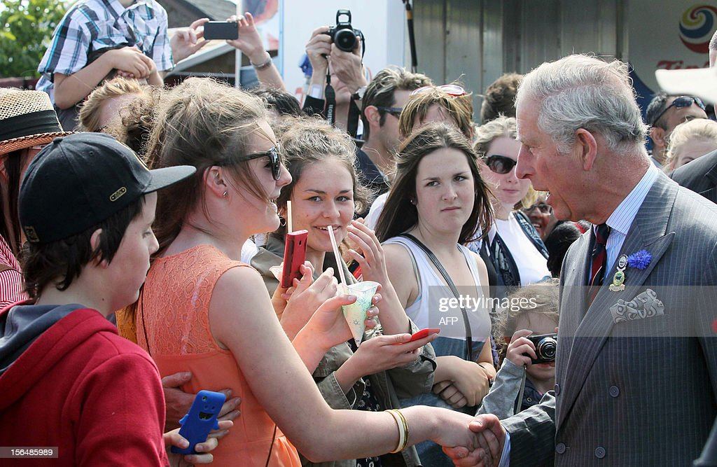 Britain's Prince Charles (R) and his wife Camilla (not pictured) meet well wishers during their visit to the Canterbury A and P show in Christchurch on November 16, 2012. Britain's Prince Charles and his wife Camilla are on the last leg of a tour to mark Queen Elizabeth II's diamond jubilee which has also included Papua New Guinea and Australia and ends on November 16. AFP PHOTO / POOL / Kirk Hargreaves