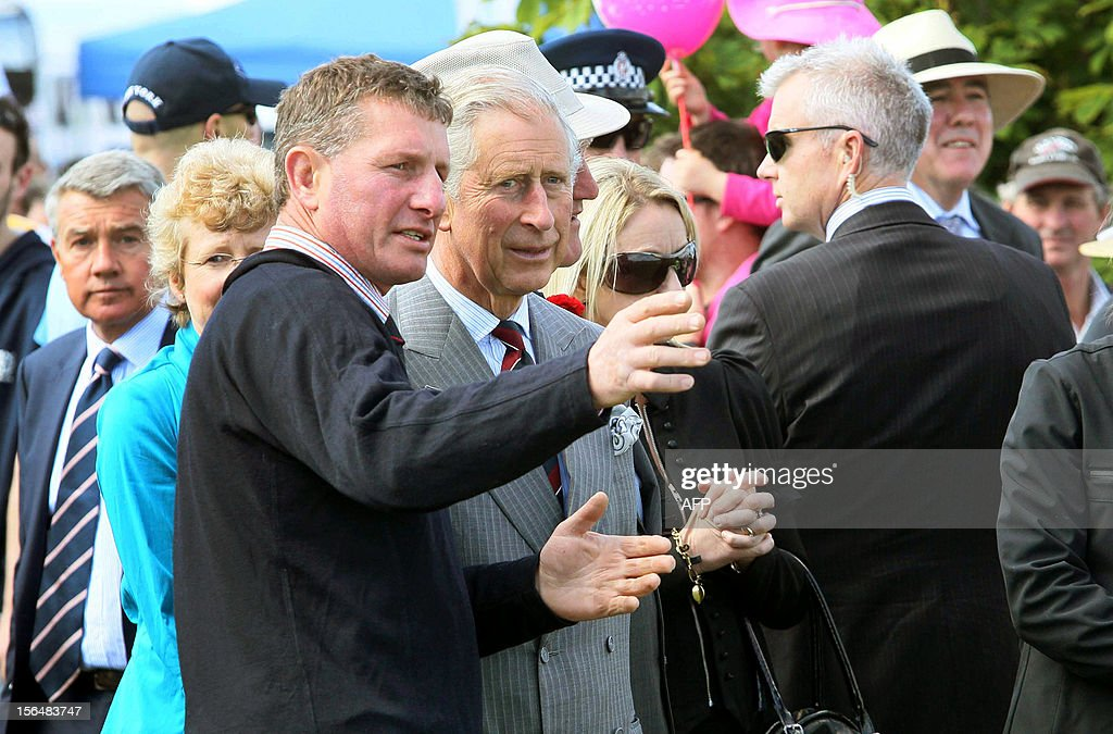 Britain's Prince Charles (C) and his wife Camilla (not pictured) visit the Canterbury A and P show in Christchurch on November 16, 2012. Britain's Prince Charles and his wife Camilla are on the last leg of a tour to mark Queen Elizabeth II's diamond jubilee which has also included Papua New Guinea and Australia and ends on November 16. AFP PHOTO / POOL / Kirk Hargreaves