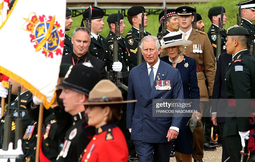 Britain's Prince Charles and Princess Camilla arrive for the commemoration of the 100th anniversary of the Battle of the Somme at Terre-Neuvien cemetery in Beaumont-Hamel on July 1, 2016. / AFP / FRANCOIS