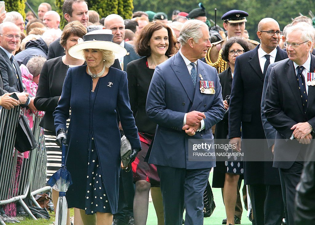 Britain's Prince Charles and Princess Camilla arrive on July 1, 2016 at Ulster Tower in Thiepval for the commemoration of the 100th anniversary of the Battle of the Somme. / AFP / FRANCOIS
